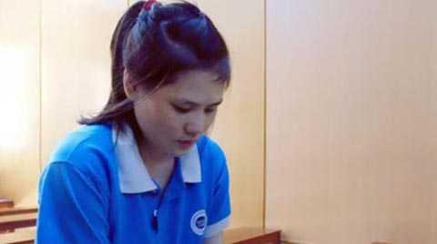 Lê Thị Liên tại phiên tòa ngày 14/4. Ảnh: Tân Châu.