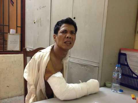 Đối tượng Phạm Xuân Sơn tại trụ sở cảnh sát.     Ảnh: Nguyễn Vũ