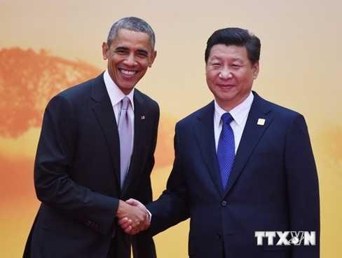 Chủ tịch Trung Quốc Tập Cận Bình gặp Tổng thống Mỹ Barack Obama bên lề Hội nghị cấp cao APEC - Ảnh: TTXVN