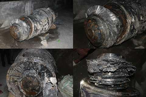 Khối sắt nặng 1,5 tấn nghi là đuôi máy bay được ngư dân tìm thấy và trục vớt. (Ảnh: Văn Đức)