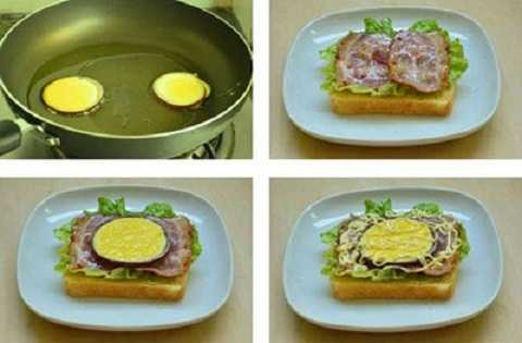 Tiếp theo, đặt 2 vòng hành tây vào chảo, dùng muỗng múc trứng đổ vào trong 2 vòng tròn hành tây, chiên chín trứng. Đặt lát bánh mỳ sandwich trên đĩa, rồi đặt 2 lá xà lách lên trên, đặt thêm 2 lát thịt xông khói đã rán vàng. Tiếp đến, đặt khoanh hành tây với trứng lên trên lớp thịt xông khói. Cuối cùng, rưới lớp sốt mayonnaise lên trên là xong.