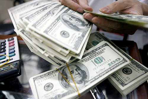 Tổ chức nước ngoài đánh giá cao động thái liên tục phá giá tiền Đồng của Ngân hàng Nhà nước