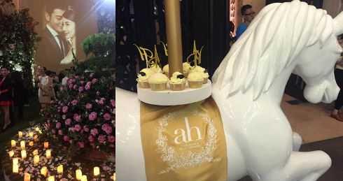 Bánh cưới và hoa, nến ngập tràn.