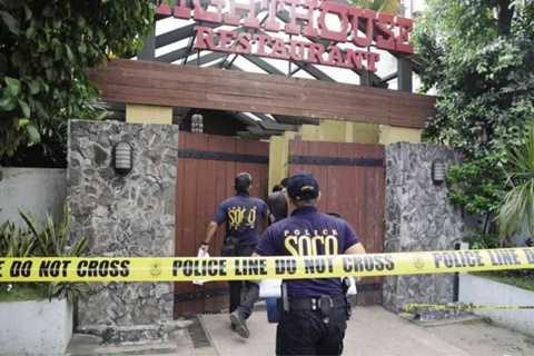 Cảnh sát niêm phong nhà hàng Lighthouse nơi xảy ra án mạng - Ảnh: Inquirer