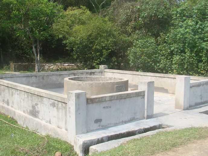Giếng làng nơi phát hiện thi thể bé C. (Ảnh: Lộc Dũng)