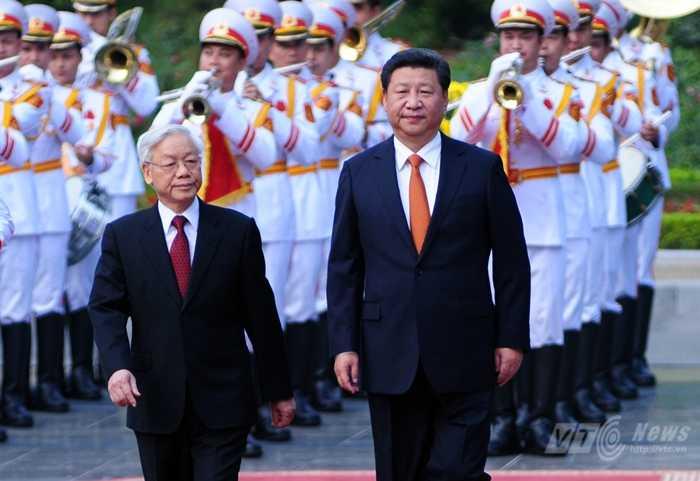 Tổng Bí thư Nguyễn Phú Trọng và Tổng Bí thư, Chủ tịch Trung Quốc Tập Cận Bình - Ảnh: Tùng Đinh