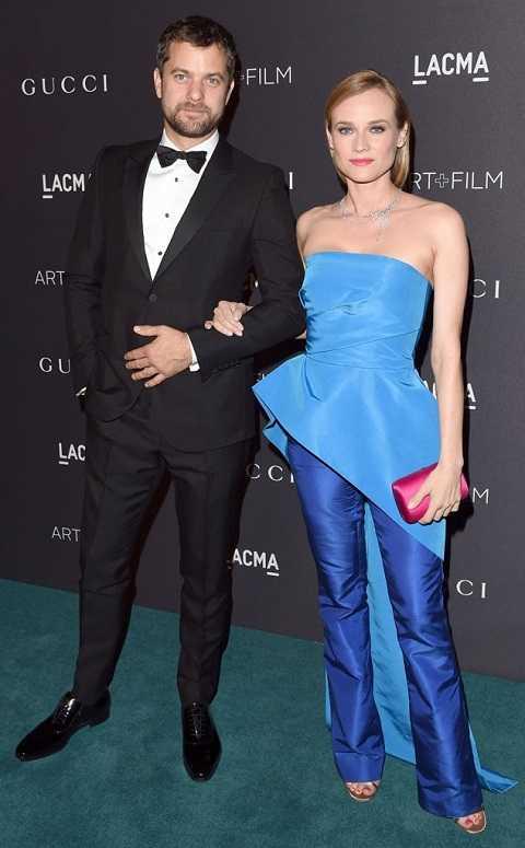 Bộ quần ống loe, áo cúp ngực bất đối xứng xanh bóng giúp Diane Kruger thêm tươi tắn tại LACMA 2015 Art + Film Gala.