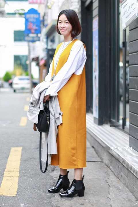 ầm vàng bật lên trên chiếc áo sơ-mi cách điệu trắng cùng boots đen cho bạn phong cách trẻ trung, hiện đại.