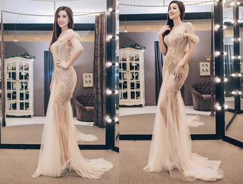 Mai Phương Thuý chọn đầm dạ tiệc đính sequin khoe vai trần quyến rũ của nhà thiết kế Phạm Đặng Anh Thư tại triển lãm thời trang.