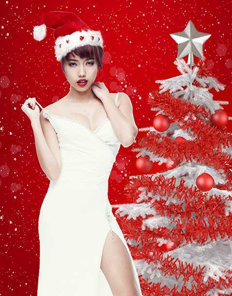 Diệu Nhi diện đầm dạ hội trắng tinh khôi. Thiết kế xẻ cao phát huy lợi thế ngoại hình và phong cách gợi cảm của cô. Khác với phong cách