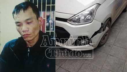 Đối tượng cướp taxi Nguyễn Văn Tú cùng chiếc xe taxi bị hư hại sau va chạm