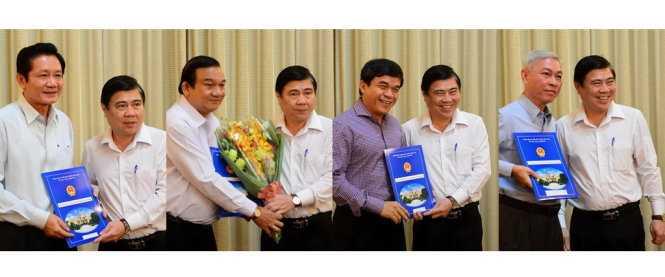 (Lần lượt từ trái qua): Ông Nguyễn Thành Phong trao quyết định cho ông Trần Trung Dũng, ông Lê Minh Tấn, ông Nguyễn Qúy Hòa, ông Nguyễn Pôn - Ảnh: Quang Định