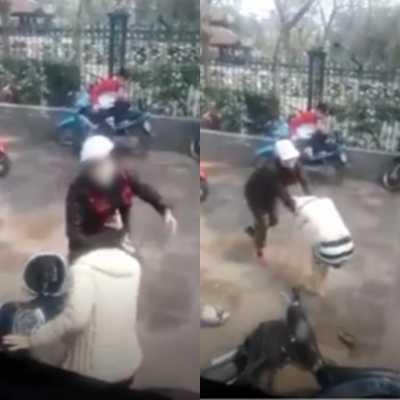 Hình ảnh người phụ nữ mang bầu bị đánh ngay trước cổng Văn Miếu