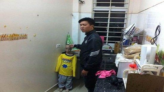 Tam giam bo ruot bao hanh da man con trai 10 tuoi o Ha Noi hinh anh 1