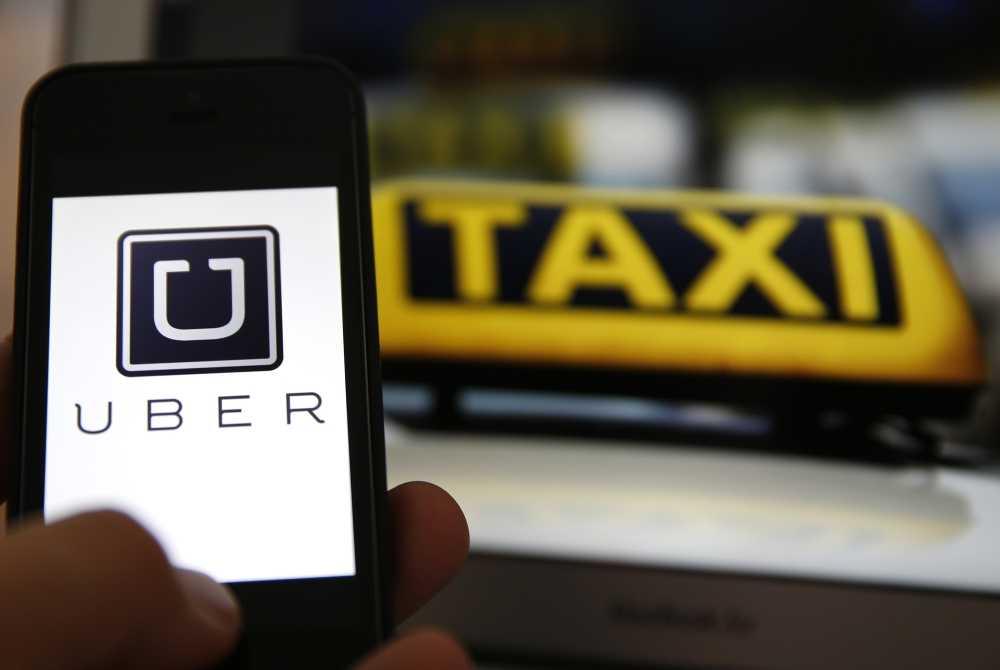 'Xu' dich vu taxi Uber, quan chuc Bo GTVT: Dung luat moi cho hoat dong hinh anh 1