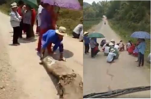 Video: Nhom phu nu, tre em dung lan chan duong 'xin deu' tien lai xe cho lon hinh anh 1