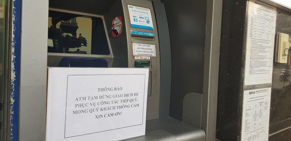 NHNN yeu cau khac phuc tinh trang het tien o cac cay ATM hinh anh 1