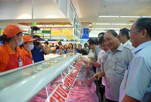 Chum anh: Thu tuong Nguyen Xuan Phuc, Pho Thu tuong Vu Duc Dam trong quan pho binh dan hinh anh 8