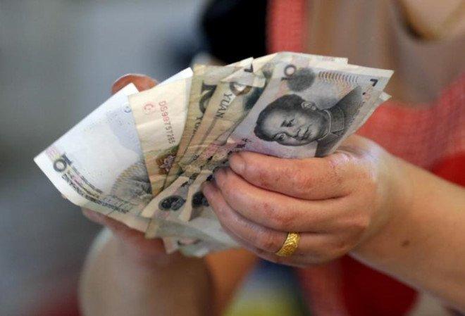 Quan tham Trung Quoc bon rut tien tro cap cua dan 60.000 lan hinh anh 1