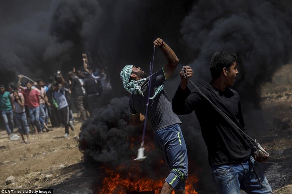 Anh: 'Ngay Thu Hai dam mau' tren dai Gaza, hang nghin nguoi thuong vong hinh anh 9
