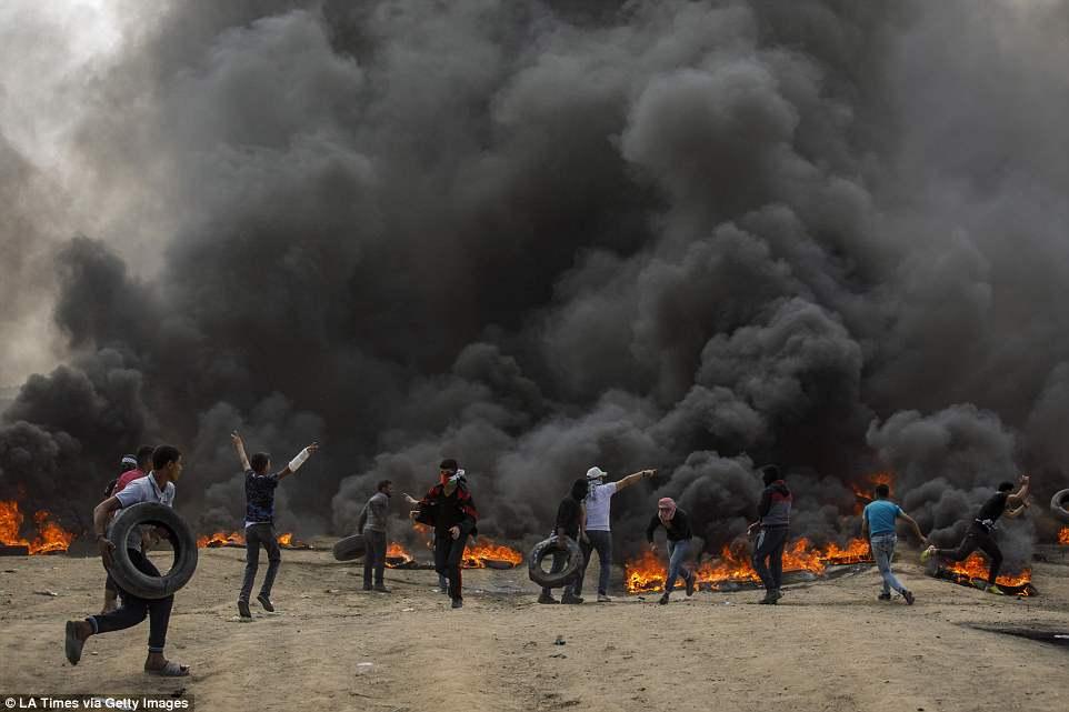 Anh: 'Ngay Thu Hai dam mau' tren dai Gaza, hang nghin nguoi thuong vong hinh anh 2