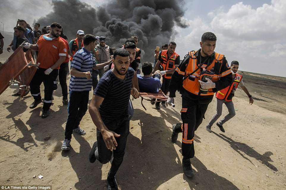 Anh: 'Ngay Thu Hai dam mau' tren dai Gaza, hang nghin nguoi thuong vong hinh anh 3
