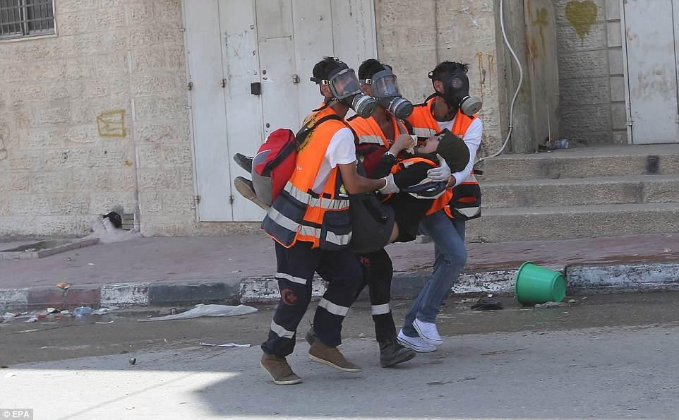 Anh: 'Ngay Thu Hai dam mau' tren dai Gaza, hang nghin nguoi thuong vong hinh anh 8