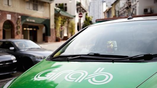 Singapore dieu tra thuong vu Grab mua Uber hinh anh 1