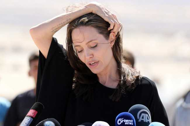 Angelina Jolie gio day chi con 34 kg du cao gan 1m70? hinh anh 6