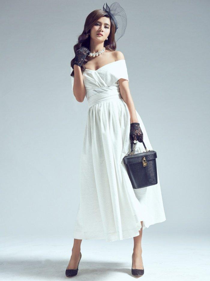 Kim Tuyen sexy nhung khong kem phan sang trong voi phong cach co dien hinh anh 1