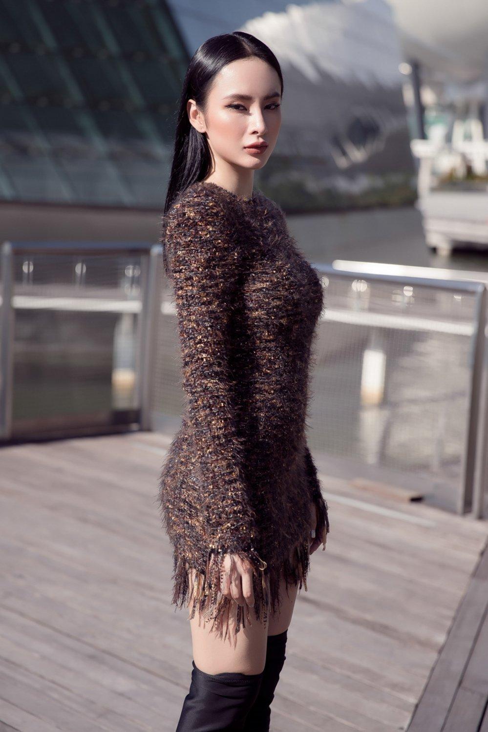 Angela Phuong Trinh khoe duong cong sexy tao bao tai Singapore hinh anh 3