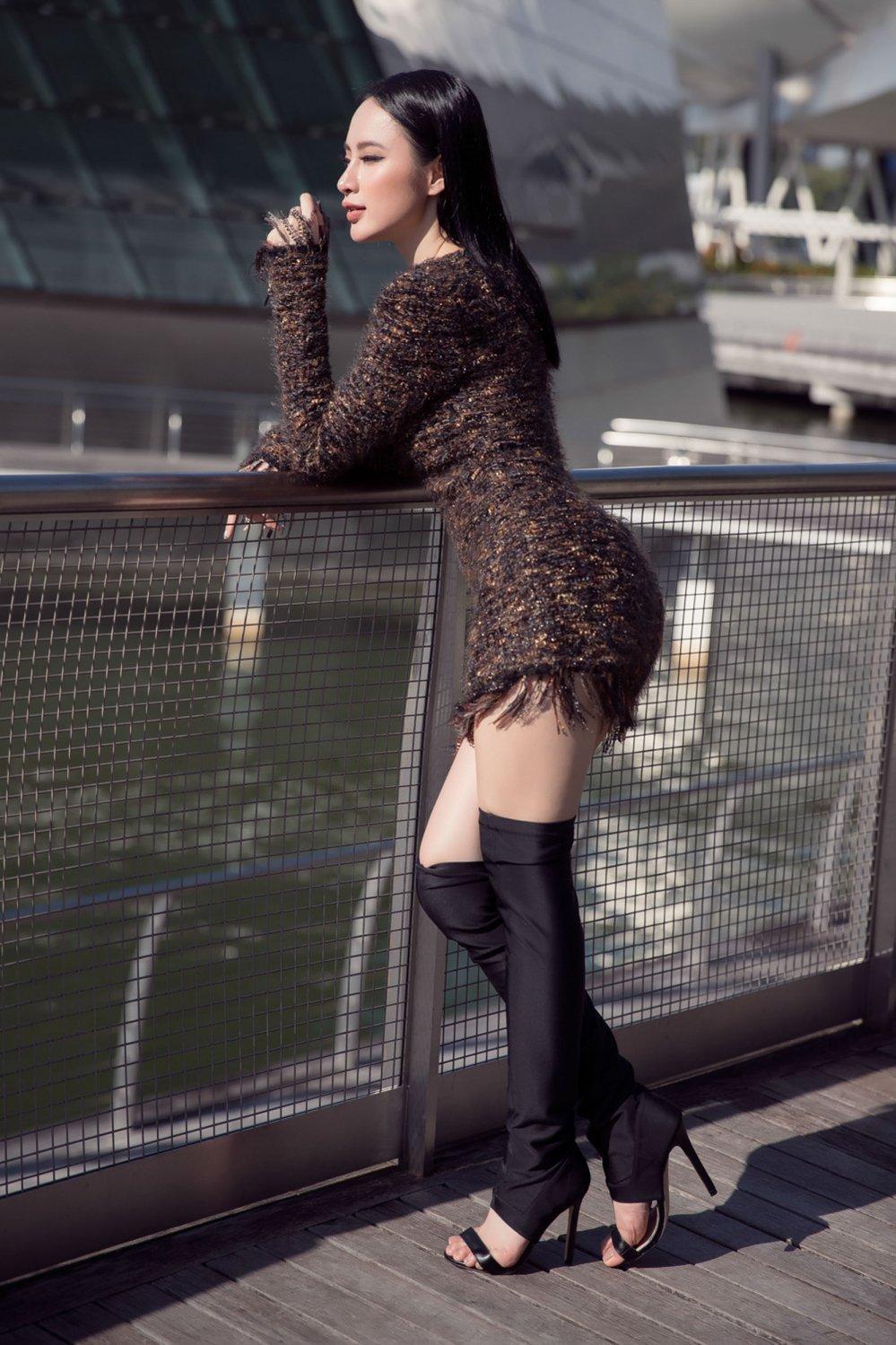 Angela Phuong Trinh khoe duong cong sexy tao bao tai Singapore hinh anh 4