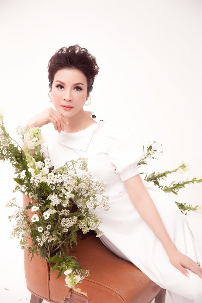 MC Thanh Mai tro lai Viet Nam sau nhung ngay don tet cung con gai o My hinh anh 5