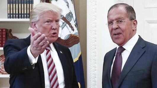 Ong Trump tuyen bo co quyen 'tuyet doi' khi chia se tin voi Nga hinh anh 1
