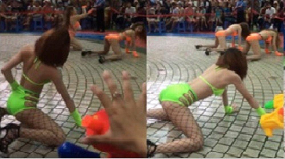 Dan chan dai mac bikini nhay nhot phan cam truoc hang tram tre em trong cong vien Dam Sen hinh anh 1