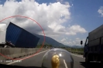 Tránh ô tô ngược chiều, container hoảng hồn đánh lái đè lên dải phân cách