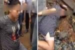 Trung Quốc: Ăn cắp tiền, bà bầu bị dân làng trói vào cột đánh
