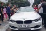 Bố cầm búa đập vỡ kính xe BMW giải cứu con gái