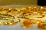 Giá vàng tăng khiêm tốn, giá USD 'chợ đen' giảm sâu