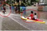 Clip: Dân Hải Phòng phấn khích lướt ván băng băng trên đường ngập