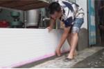 Video: Dân Hà Nội chặn cửa nhà, tát nước ngập sau bão số 3