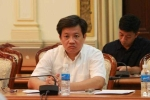 Ông Đoàn Ngọc Hải trầm tư trong phiên họp của TP.HCM