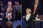 Trump đứng đầy 'hăm dọa', nhìn chằm chằm khi Clinton trả lời