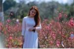 Ảnh: Thiếu nữ Tây Nguyên khoe sắc bên vườn đào Nhật Tân