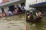 Clip: Ngập gần 2m, dân nô nức đi thuyền, bè trên quốc lộ 6