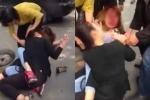 Video: Sau va chạm giao thông, hai cô gái trẻ lao vào đánh nhau giữa phố Hà Nội