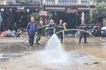 Ảnh: Hơn 1.000 cảnh sát, bộ đội dầm mưa dọn bùn sau lũ phục vụ APEC