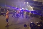 Chạy xe máy gần nhóm đua xe, nam thanh niên đi đường bị bắn chết
