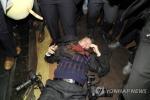 Nhà báo đi cùng Tổng thống Hàn Quốc bị bảo vệ Trung Quốc đánh hội đồng