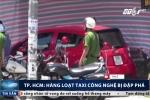 TP.HCM: Đỗ trước nhà hàng, hàng loạt taxi công nghệ bị đập phá